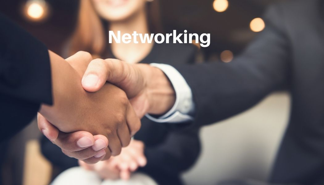 people shaking hands for networking
